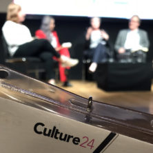 Culture24 conference programme lanyard in front of speakers