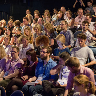 Photo of an audience full of people